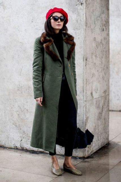 With black shirt, black trousers, flats and midi coat