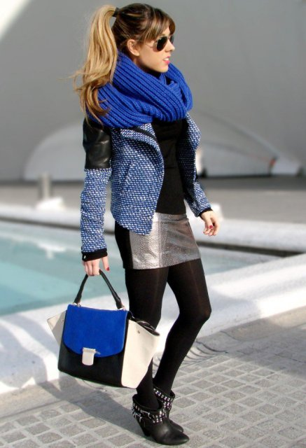 With black shirt, mini skirt, black tights, embellished boots, tweed and leather jacket and tote