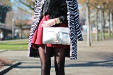 With black shirt, red skirt, white bag and high heeled boots