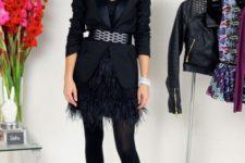 With black top, black blazer, belt, black tights and pumps