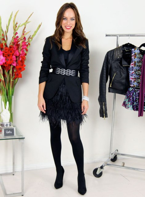 With black top, black blazer, belt, black tights and pumps