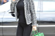 With black turtleneck, black skinny pants, green tote and high boots