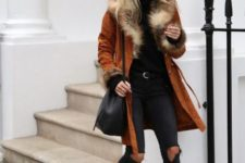 With black turtleneck, distressed pants, animal printed boots and black bag