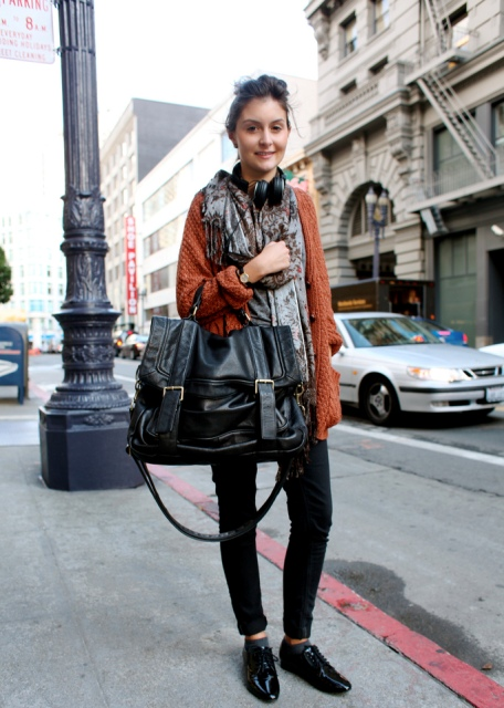 With brown cardigan, floral shirt, black pants and patent leather shoes