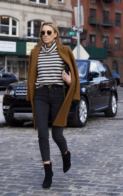 With brown coat, crop jeans, clutch and black ankle boots