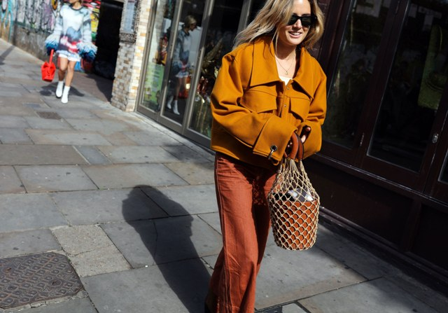 With brown jacket and orange pants