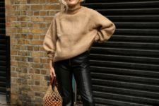 With brown oversized sweater, leather crop pants and black boots
