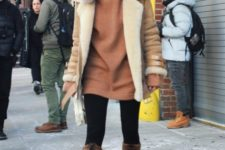 With brown sweatshirt dress, black tights, jacket and fur boots