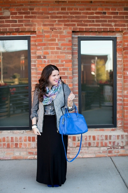 With button down shirt, vest, maxi skirt and blue bag