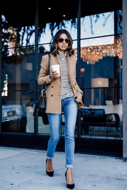 With camel jacket, cuffed jeans, black pumps and black bag