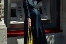 With dark colored maxi dress and white sneakers
