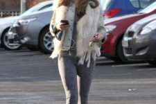 With denim jacket, fur vest, leggings and pink sneakers