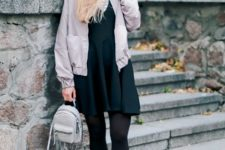 With dress, black tights, emerald boots, black hat and pastel colored jacket