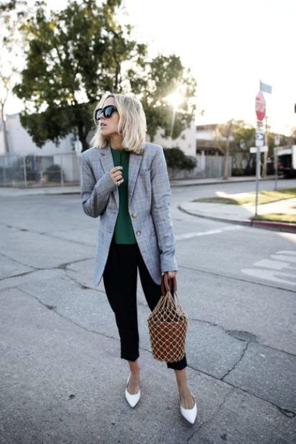 With emerald blouse, long blazer, crop pants and white shoes