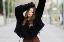 With faux fur loose sweater and black bag
