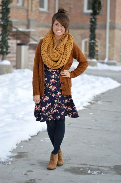 With floral dress, black tights, brown cardigan and lace up boots