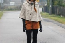 With fur hat, black tights, black high heeled boots, black gloves and beige cape coat