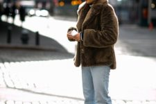 With fur jacket, loose jeans and heeled shoes