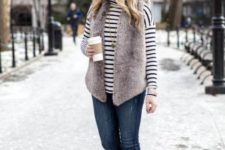 With fur vest, jeans and suede boots