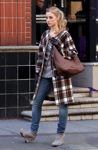 With gray sweatshirt, checked coat, jeans and gray suede boots
