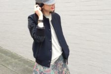 With gray t-shirt, navy blue jacket and printed skirt