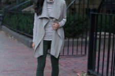 With gray vest, green pants and lace up boots