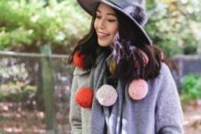 With gray wide brim hat and gray straight coat