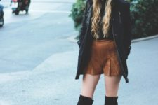 With green pom pom hat, black coat and over the knee boots