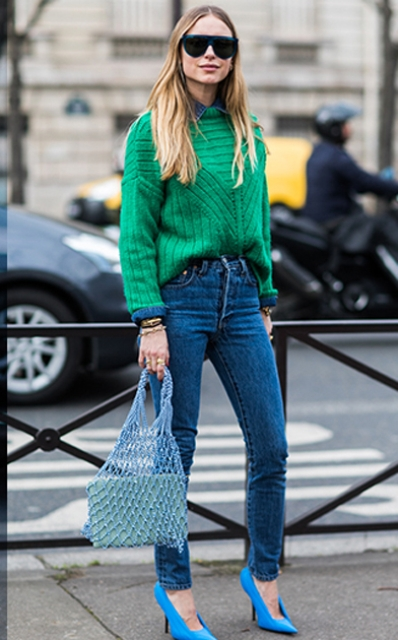 With green sweater, jeans and blue high heels