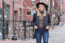With hat, blazer, black bag, skinny jeans and over the knee boots