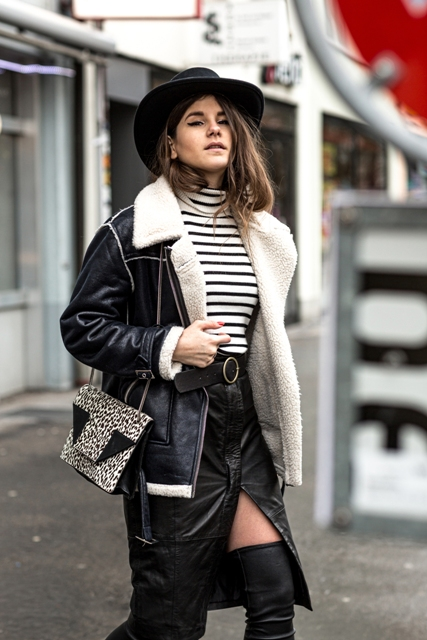 With hat, fur coat, printed bag, leather skirt and over the knee boots