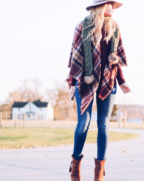 With hat, skinny jeans and brown ankle boots