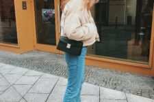 With jeans, black flat boots, chain strap bag and hat