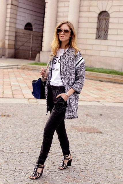 With labeled shirt, leather pants, blue bag and embellished shoes