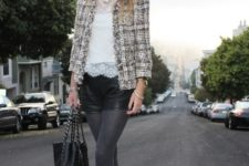 With lace blouse, gray tights, black leather shorts, metallic ankle boots and black tote