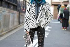With leather jacket, zebra printed clutch, distressed pants and lace up boots
