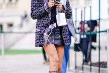 With leather mini skirt, printed jacket and bag
