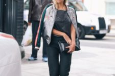 With leather shirt, straight pants, flat shoes and black clutch
