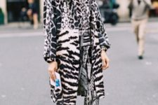 With leopard printed shirt, snake printed pants and black and beige shoes
