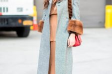 With light brown maxi dress, red sock boots and red bag