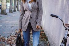 With light gray turtleneck, printed blazer, cuffed jeans, black bag and velvet boots