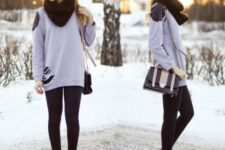 With long sweatshirt, black leggings, two colored bag and ankle boots