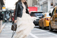 With maxi dress, black leather jacket and flat shoes