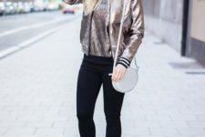 With metallic shirt, black skinny pants, high heels and white round bag