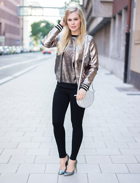 With metallic shirt, black skinny pants, high heels and white round bag
