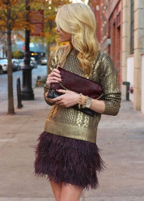 With metallic sweater and marsala clutch