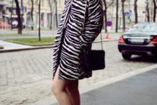 With mini dress, orange high heels and black bag
