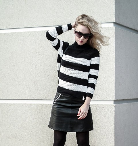 With mini skirt and black tights