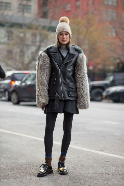 With mini skirt, flat boots, black tights and fur sleeved jacket