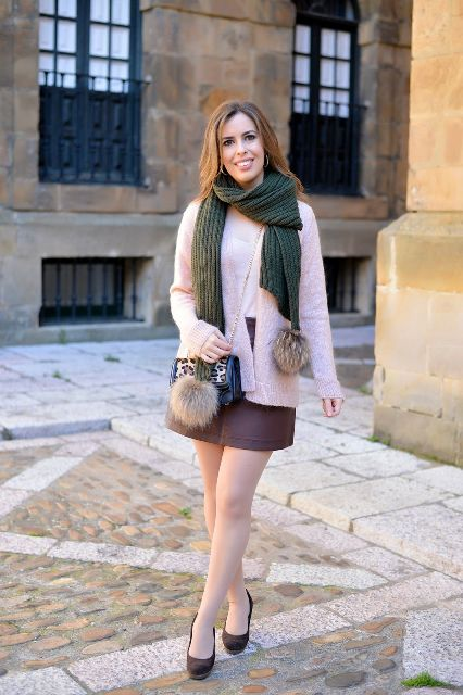 With mini skirt, pale pink jacket, chain strap bag and pumps